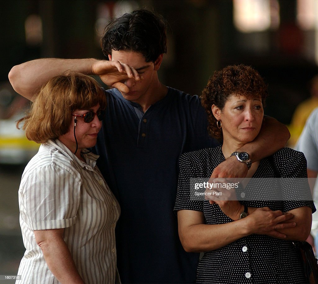 Family members of victims, who were killed by a car, mourn at a