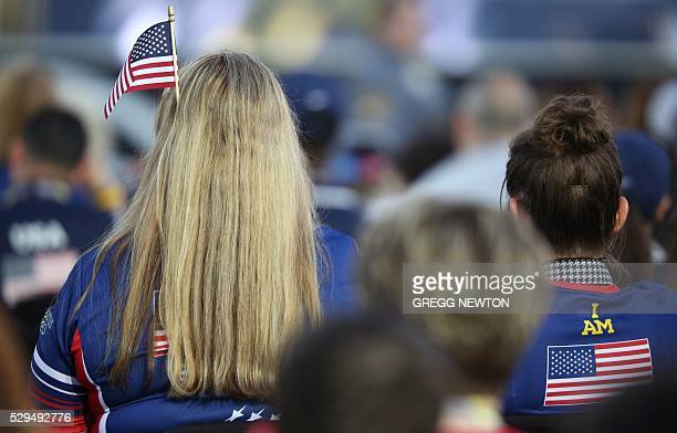 Family members of wounded US soldiers cheer them on during opening ceremonies for the 2016 Invictus Games in Orlando Florida May 8 2016 The Invictus...