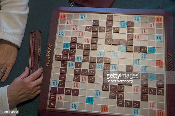 Family members on Cape Cod play Scrabble in Orleans Massachusetts on July 10 2016 Scrabble is word game trademarked by Hasbro Inc and available in 29...