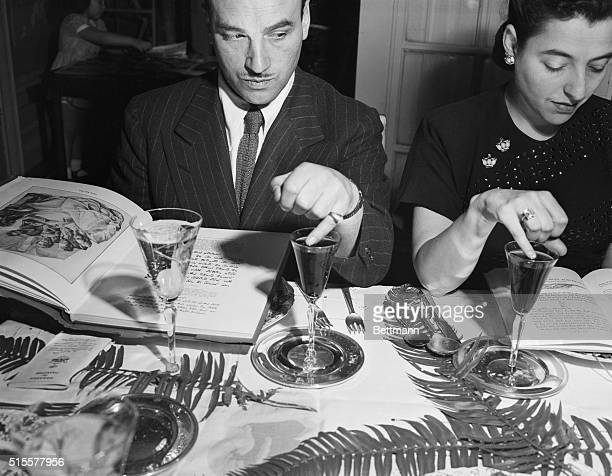 Family members place a single drop of wine on their plate for each of the ten plagues recounted in the Haggadah The tales of the Exodus are read from...