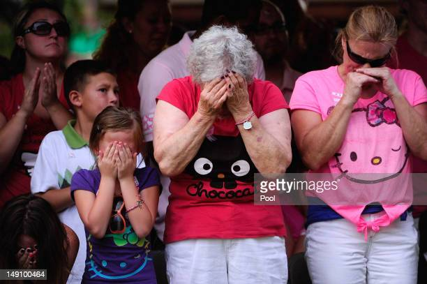 Family members react as the names of the 12 victims of the mass shooting at Century 16 movie theater are read aloud during a prayer vigil at the...