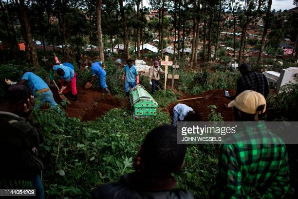 Family members react as they watch a victim of the Ebola virus being buried on May 16, 2019 in Butembo. - The city of Butembo is at the epicentre of...