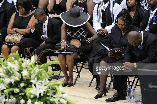 Family members react during a funeral service for former NFL quarterback Steve McNair on July 11 2009 in Hattiesburg Mississippi McNair's wife...