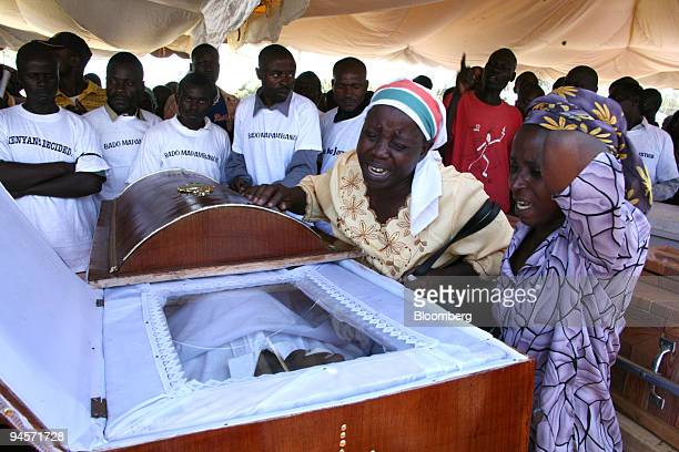 Family members react during a religious service for victims killed during the recent violence in Nairobi Kenya on Wednesday Jan 23 2008 Former United...