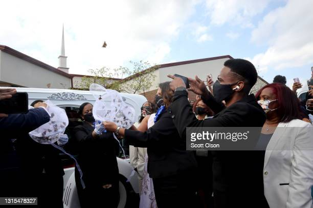 Family members release butterflies next to the hears carrying the remains of 16-year-old Ma'Khia Bryant following her funeral service at First Church...