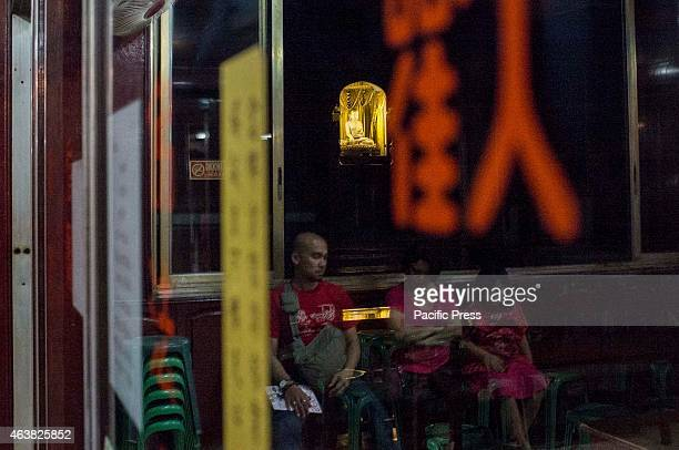 Family members rest in one of the shrines of Seng Guan Temple hours before the Chinese New Years day