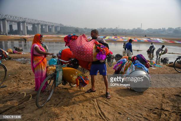 Family members seen helping each other to carry the clothes on their bicycle Dhobi's and their families are directly involve in the washing...