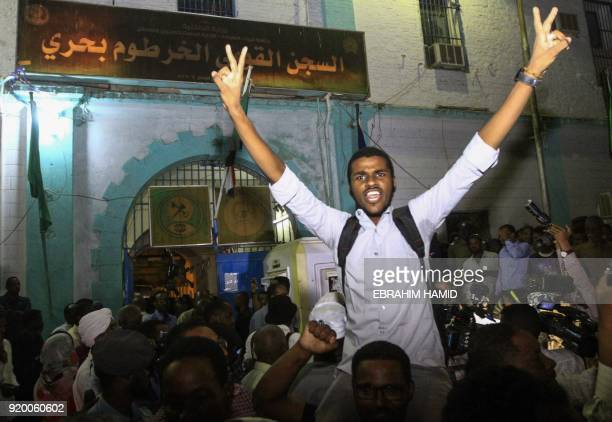 Family members shout slogans as they wait outside the Kobar prison in north Khartoum to welcome their loved ones after Sudan released dozens of...