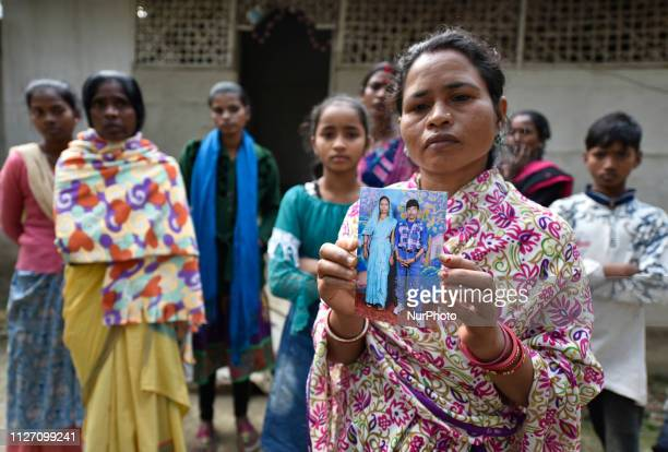 Family members shows a photograph both died after consuming spurious liquor at a tea garden in Golaghat Assam India on Saturday Feb 23 2019 At least...