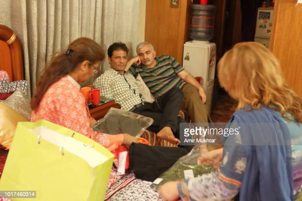 Family members sitting together and having gossips in a living room