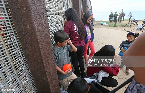 Family members speak with loved ones along the United StatesMexico Border wall during Opening the Door Of Hope/Abriendo La Puerta De La Esparana at...