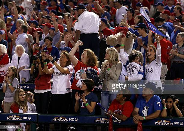 Family members support players from the Texas Rangers after the Rangers won 6-1 against the New York Yankees in Game Six of the ALCS during the 2010...