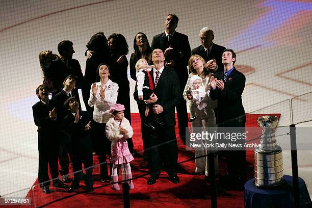 Family members surround former New York Rangers' captain Mark Messier who holds son Douglas Paul and his fiance Kim Clark who carries their daughter...
