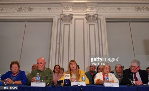 Family members survivors and campaigners for the victims of the Hillsborough Disaster hold a press conference in Liverpool northwest England on...