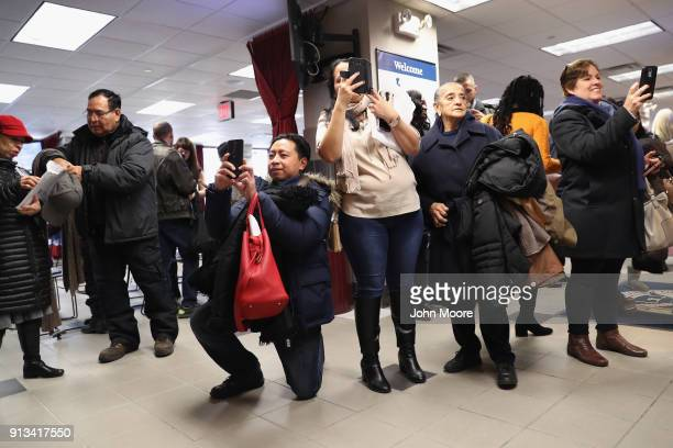 Family members take photos of new American citizens following a naturalization ceremony on February 2 2018 in New York City US Citizenship and...