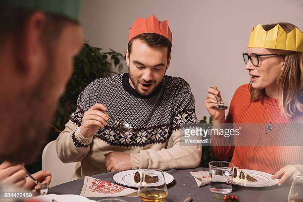 Family members talking while having Christmas pudding