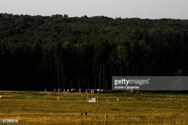Family members tours the crash site of Flight 93 before attenting a memorial service on the third anniversary on the terrorist attacks of September...