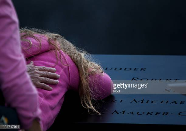 Family members visit the South Pool of the 9/11 Memorial during the tenth anniversary ceremonies of the September 11 2001 terrorist attacks at the...
