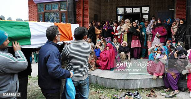 Family members wail as the body of martyred soldier Havildar Jagdish Chand who lost his life while fighting terrorists in Pathankot is brought at his...
