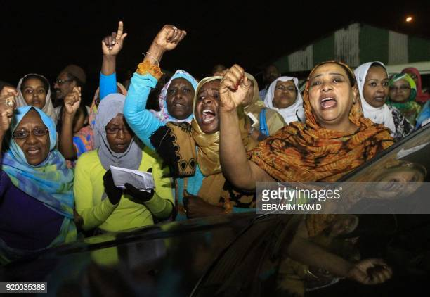 Family members wait outside the Kobar prison in north Khartoum to welcome their loved ones after Sudan released dozens of opposition activists who...