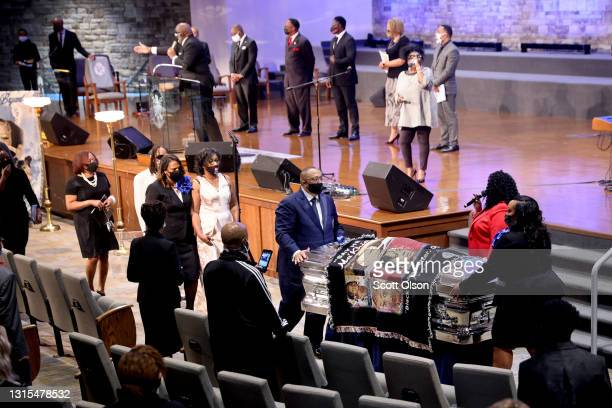 Family members walk behind the remains of 16-year-old Ma'Khia Bryant following her funeral service at First Church of God on April 30, 2021 in...