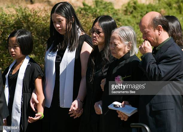 Family members watch as Annie Le's casket is loaded into a hearse at Holy Trinity Catholic Church in El Dorado Hills California Saturday September 26...