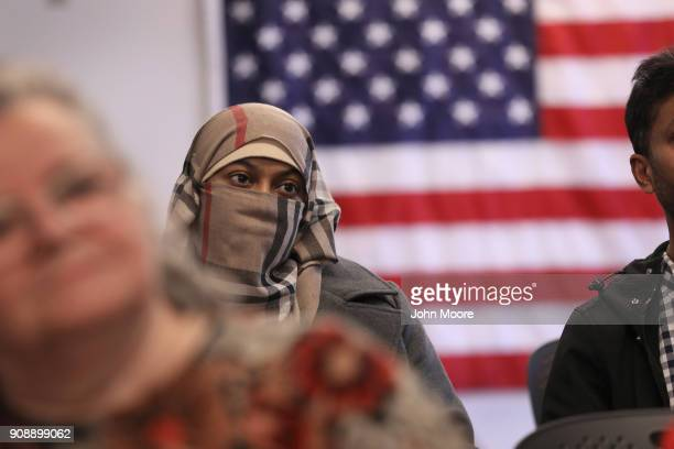 Family members watch as immigrants become American citizens at a naturalization ceremony on January 22 2018 in Newark New Jersey Immigrants from 32...