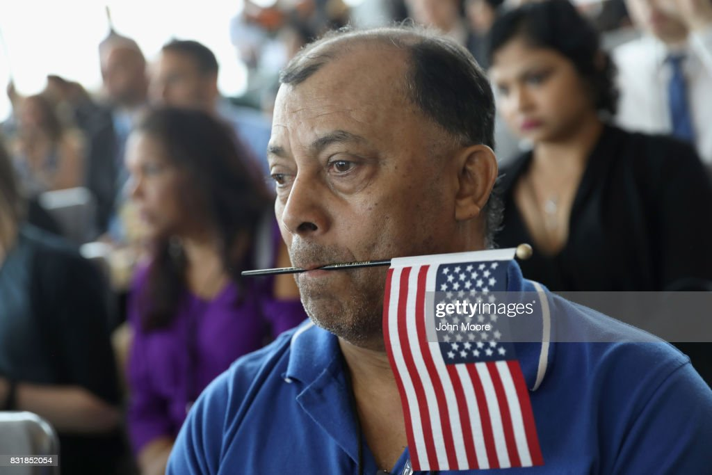 Family members watch as their loved ones take part in a naturalization ceremony held in the observatory of the One World Trade Center on August 15, 2017 in New York City. Thirty immigrants took the oath of citizenship to become American citizens at One World Trade, which at 1,776 feet high is the tallest building in the Western Hemishere.
