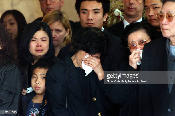 Family members weep during a traditional Buddhist funeral service for Stuyvesant High School freshman April Lao at the Chun Fook Funeral Home in...
