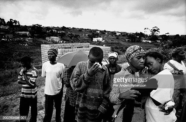 family members weeps as funeral is held for woman that died of hiv/aids in gamalakhe, south africa - 1999 stock pictures, royalty-free photos & images