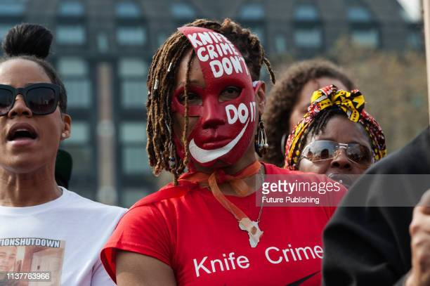 Family members who have lost a person to knife crime campaigners and demonstrators gather on Waterloo Bridge as they take part in 'Operation...