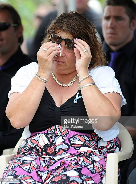 Family menmber of the deseased mourns at the funeral of mother and son killed in last week's flash floods on January 19 2011 in Toowoomba Australia...