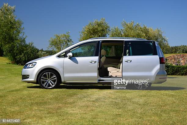family minivan on the grass - mini van stock photos and pictures