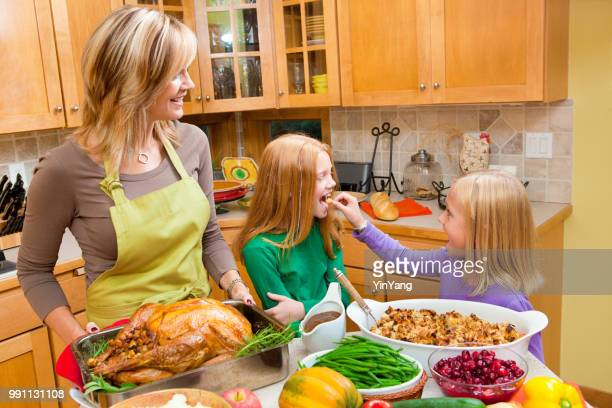Family Mother & Daughter Preparing Thanksgiving and Christmas Roast Turkey Dinner