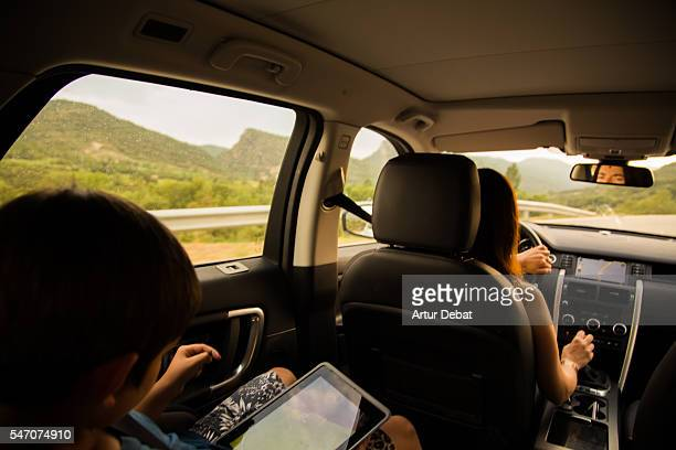 Family mother driving a suv car during a road trip travel through the Catalan Pyrenees roads.