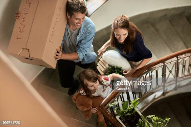family moving home - new home stock pictures, royalty-free photos & images