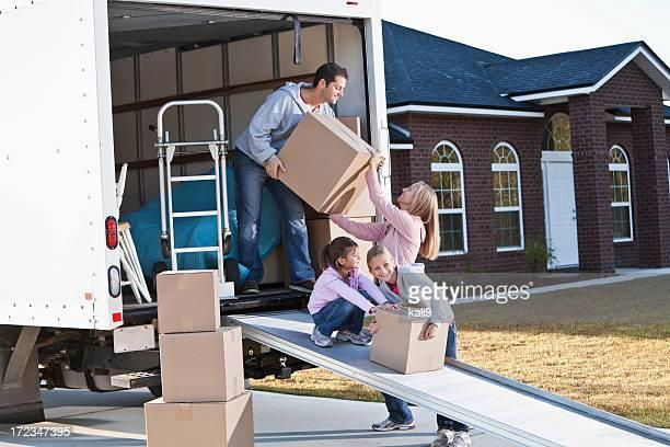 Family moving house, unloading truck