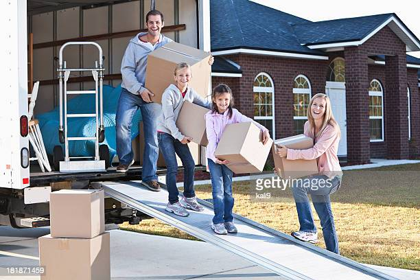 Family moving house, unloading truck