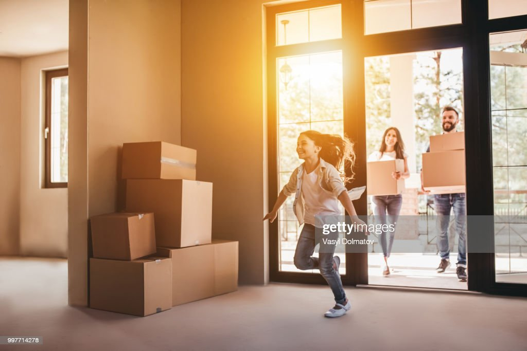 Family moving in new house : Stock Photo