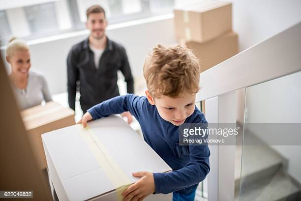 family moving into new building - unpacking stock pictures, royalty-free photos & images