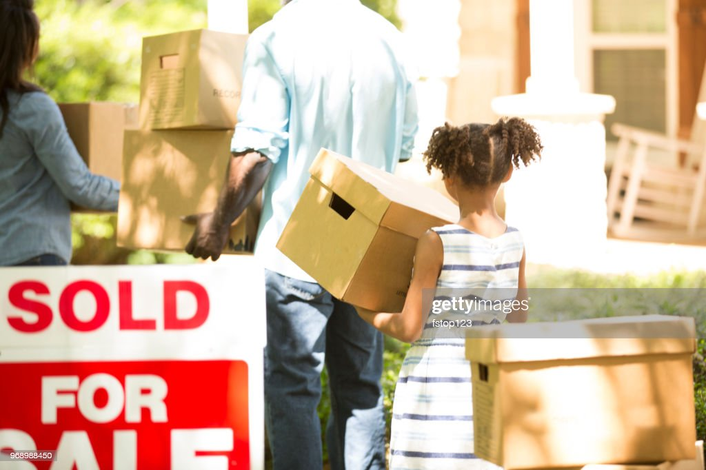 Family moving into new home. : Stock Photo