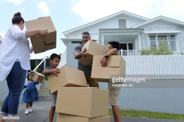 family moving into their new home - rafael ben ari stock-fotos und bilder