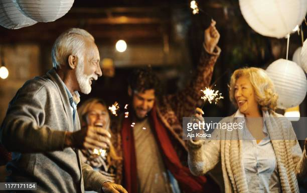 family new year's eve party. - celebration stock pictures, royalty-free photos & images