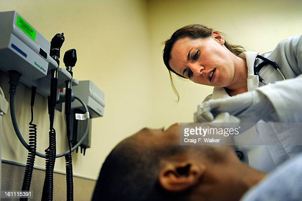 042810_HOSPITAL_CFW Family Nurse Practitioner Amy Quinone examines Medicaid patient Thomas Crippen at Denver Health's Adult Urgent Care Clinic...