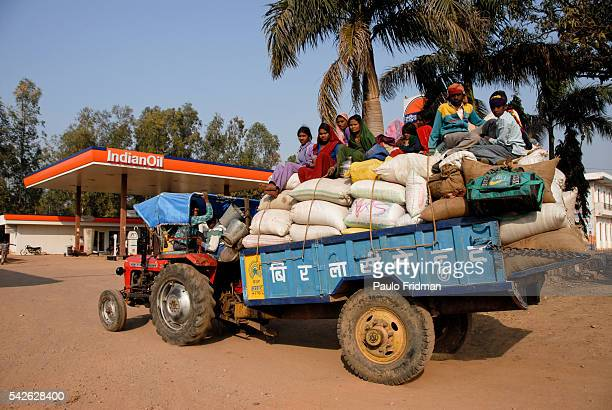 A family of agriculturists on a tractor in a Indian Oil gas station in Khajuraho Madhya Pradesh India