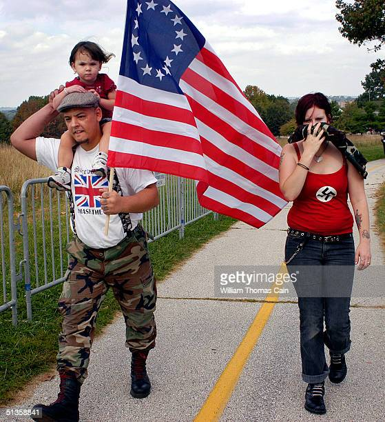 A family of American Nazi party members arrives for an American Nazi rally at Valley Forge National Park September 25 2004 in Valley Forge...