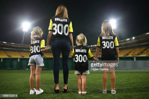 Family of Andrew Durante wife Sarah and daughters Adalyn Milana and Evita look on while wearing commemorative tops for his 300th game during the...