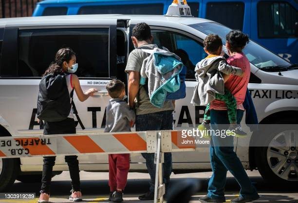 Family of asylum seekers takes a taxi to the airport for onward travel within the U.S. After being released by U.S. Immigration authorities on...