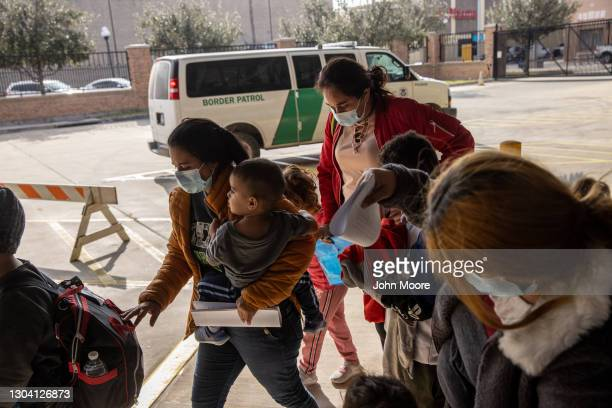 Family of Central American asylum seekers arrives to a bus station after being dropped off by U.S. Border Patrol agents on February 25, 2021 in...