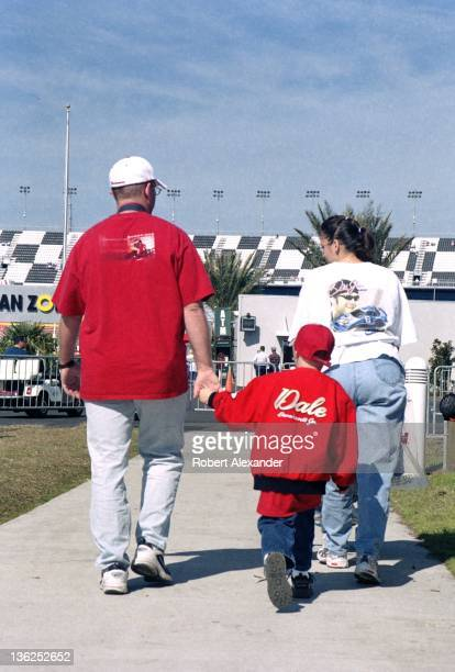 A family of Dale Earnhardt Jr fans walk toward the Fan Zone prior to the 2005 Daytona 500 on February 20 2005 at the Daytona International Speedway...